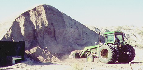 Photo of a loader at a stockpile of mineral